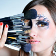 Stock Photo: Portrait of beautiful womwith make up brushes