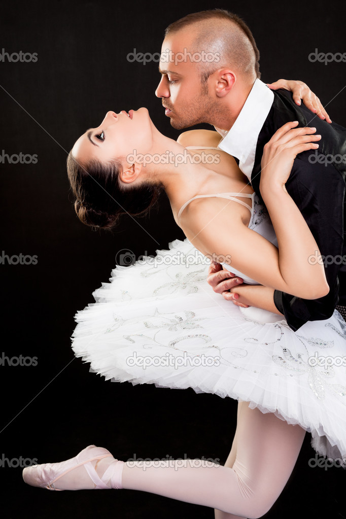 Man passionately hugging beautiful ballerina on dark background — Stock Photo #10855748