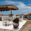 Greek taverna on the beach - Stock Photo