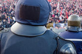 Back of policeman guarding fans — Stock Photo