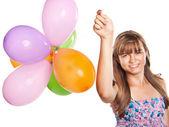 Teenage girl playing with balloons — Stock Photo