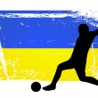 Soccer player in front of the ukraine flag — Stock Photo
