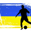Soccer player in front of the ukraine flag — Stock Photo #10817997