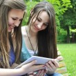Girls using a tablet — Stock Photo