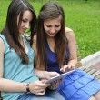 Stock Photo: Girls and tablet pc