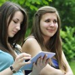 Girls with touchpad — Stock Photo #11145106