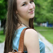Girl with book bag — Stock Photo