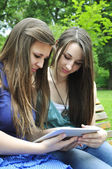Girls using a tablet pc — Stock Photo