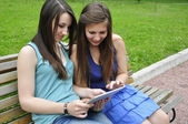 Girls and tablet pc — Stock Photo