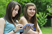Girls with touchpad — Stock Photo