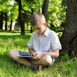 Stock Photo: Boy using tablet pc