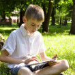 Boy with tablet pc - Stock Photo