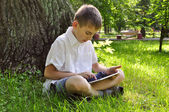 Boy using tablet pc — Stock Photo