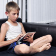 Boy using a tablet pc — Stock Photo