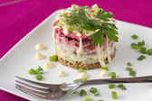 Traditional Russian Beetroot and herring salad with cooked vegetables — Stock Photo