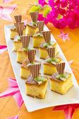 Square mini sponge cakes — Stock Photo