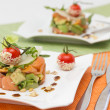 Avocado and salmon salad on square plate - Stock Photo