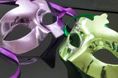 Purple and Green Mask on black background — Stock Photo
