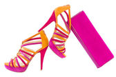 Pare of pink and orange shoes and a matching bag, isolate on white — Stock Photo