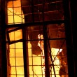 Flame comes out of window — Stock Photo #11529566