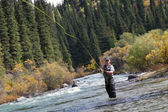 Fisherman fly fishing — Stock Photo