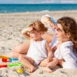 Stock Photo: Mother with little daughter on the beach