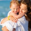 Stock Photo: Mother and daughter on the beach