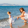 Mother with little daughter on the beach — Stock Photo