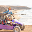 Stock Photo: Young woman on buggy