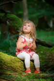 Little girl in the forest — Stock Photo