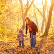 Mother and daughter in the park — Stock Photo #12330895
