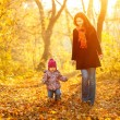 Mother and daughter in the park — Stock Photo #12330900