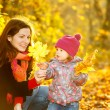 Stock Photo: Mother and daughter in the park