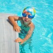 Boy in a swimming pool — Stock Photo