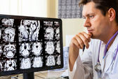 Doctor looking at ct scan — Stock Photo
