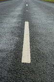 White lane markings — Stock Photo