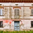 Stock Photo: Facade of old ruined house