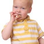 Kid eating cookies — Stock Photo