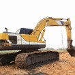Excavator Loader with backhoe standing in sandpit — Stock Photo #11145322
