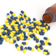 Perspective of Open pill bottle with capsule spilling out of it — Stock Photo #11145959
