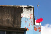 Red satellite dish on building — Stock Photo