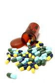 Kleurrijke capsule morsen uit uit pil fles — Stockfoto