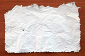 Wrinkled White paper attach on Wooden Board — Stockfoto