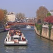 Tourist cruise boat in Paris France — Stock Photo #11163519