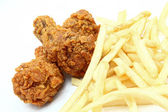 Chicken wing with french fries — Stock Photo