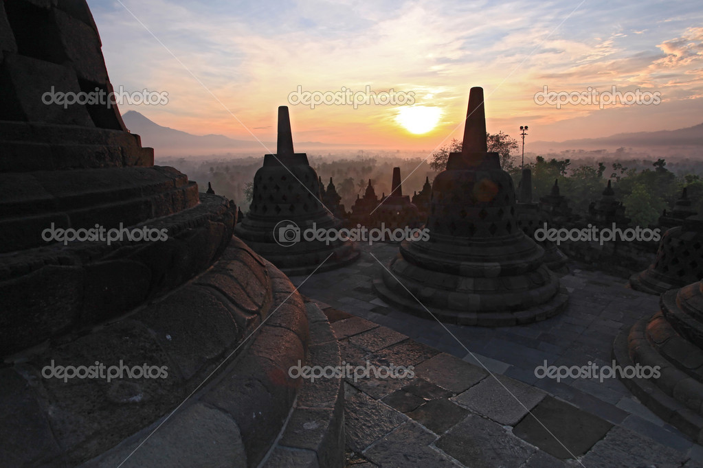 Silhouette of Ancient stupa Borobudur Temple, sunrise in Yogyakarta, Java, Indonesia. — Stock Photo #11163479