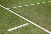 White line on soccer football field — ストック写真