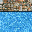 Irregular stone pavement with pool edge background — Stock Photo