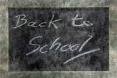 Grunge chalkboard or blackboard with text Back to School — Stock Photo