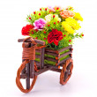 Beautiful and colorful flower bouquet in wooden basket in car sh — Stock Photo